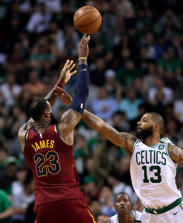. Cleveland Cavaliers forward LeBron James, left, shoots over Boston Celtics forward Marcus Morris during the second half in Game 2 of the NBA basketball Eastern Conference finals, Tuesday, May 15, 2018, in Boston. (AP Photo/Charles Krupa)