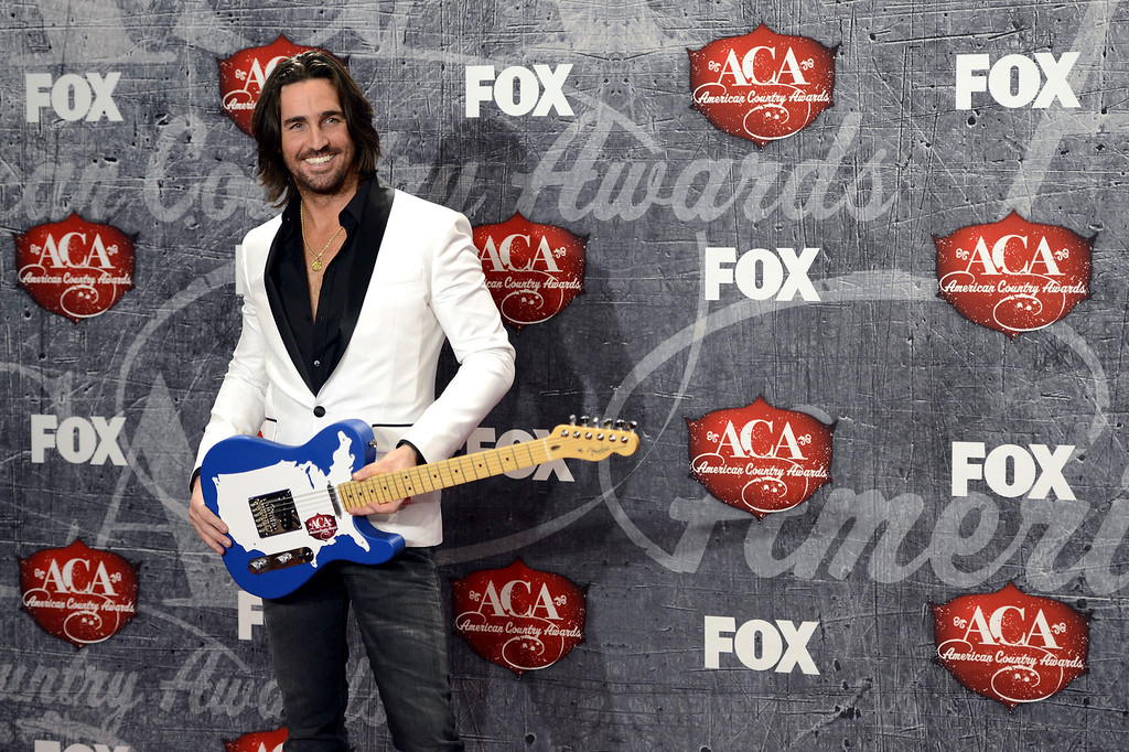 . Recording artist Jake Owen poses in the press room with his award for Breakthrough Artist of the Year backstage at the American Country Awards on Monday, Dec. 10, 2012, in Las Vegas. (Photo by Jeff Bottari/Invision/AP)