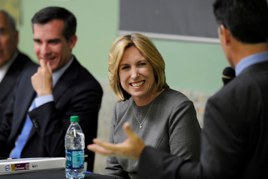 . Mayoral candidates Eric Garcetti and Wendy Greuel listen to a question by moderator Phil Shuman during their debate at Notre Dame High School, Wednesday, April 17, 2013. (Michael Owen Baker/Staff Photographer)