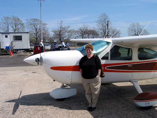 Rodica and our plane.jpg