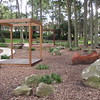 open plan timber cubby and carved timber canoe