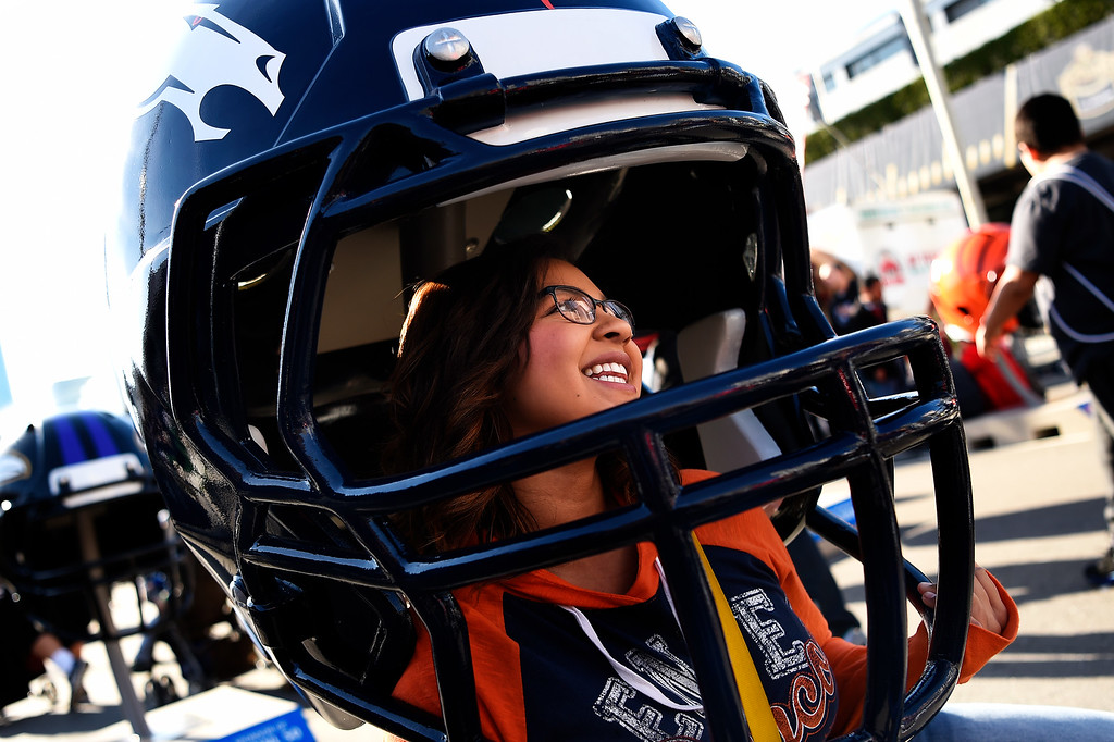 . SAN FRANCISCO, CA - FEBRUARY 05: 18 year old Savanah Austin of Utah smiling for her family in a huge Bronco helmet at the NFL Experience in downtown San Francisco, CA. February 05, 2016 (Photo by Joe Amon/The Denver Post)