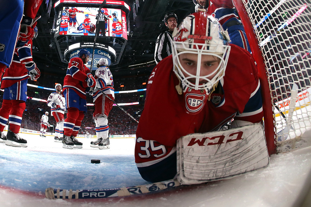 . Dustin Tokarski #35 of the Montreal Canadiens falls to the ice after a play against the New York Rangers during the third period in Game Two of the Eastern Conference Final during the 2014 Stanley Cup Playoffs at Bell Centre on May 19, 2014 in Montreal, Canada.  (Photo by Bruce Bennett/Getty Images)