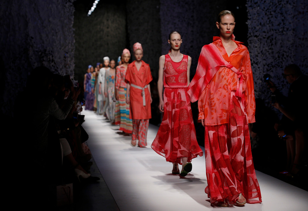. Models wear creations for Missoni women\'s spring-summer 2015 collection, part of the Milan Fashion Week, unveiled in Milan, Italy, Friday, Sept. 19, 2014. (AP Photo/Luca Bruno)