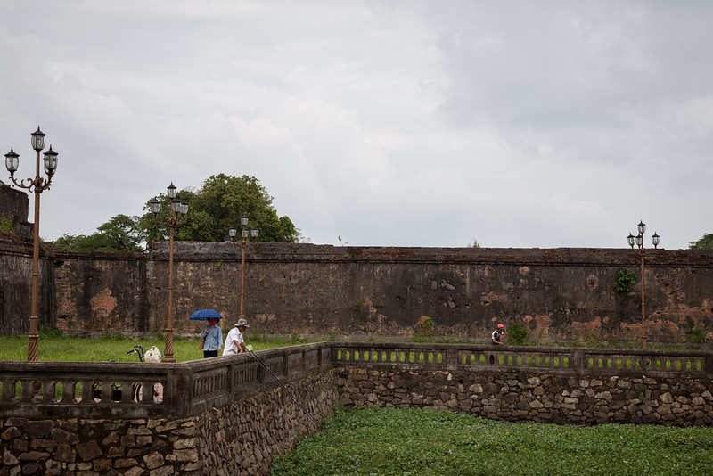 After touring the Citadel on foot, we hired a cyclo to take us around the larger perimeter of the Citadel and into some of the city. Along the way he pointed out this wall that sustained bullet and small explosive damage during the Vietnam-American war.