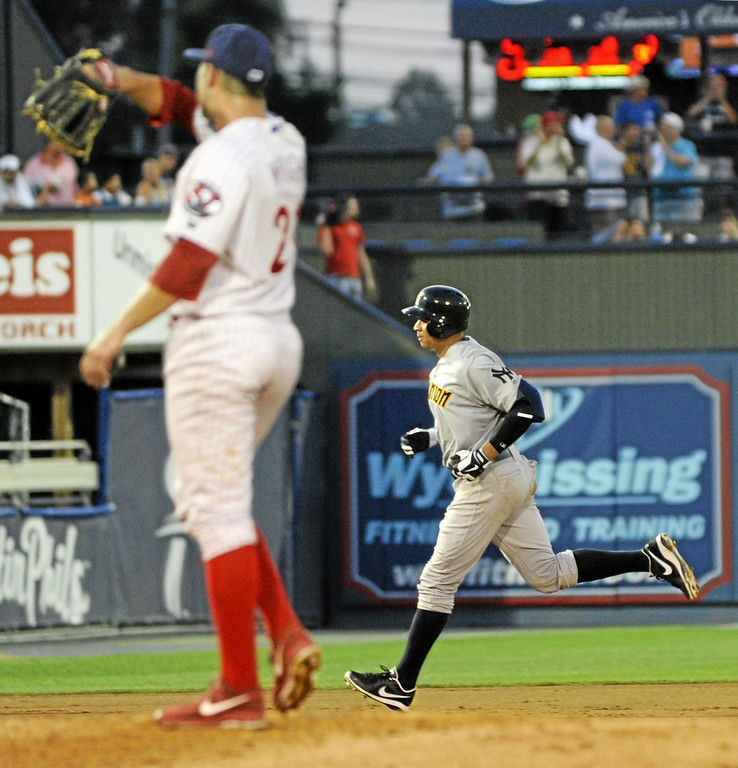 . New York Yankees\' Alex Rodriguez, right, round the bases after hitting a fourth-inning two run homer against Reading Phillies pitcher Austin Wright, left, in a Class AA baseball game with the Trenton Thunder against the Reading Phillies, Monday, July 15, 2013, in Reading, Pa. Rodriguez is doing a rehab assignment with the Thunder recuperating from hip surgery. (AP Photo/Bradley C Bower)