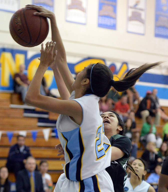 . Walnut\'s Paulina Ochoa (22) blocks the shot by Bonita\'s Ariana Abo (C) in the first half of a prep basketball game at Walnut High School in Walnut, Calif., on Wednesday, Jan. 15, 2014. Bonita won 60-50. (Keith Birmingham Pasadena Star-News)