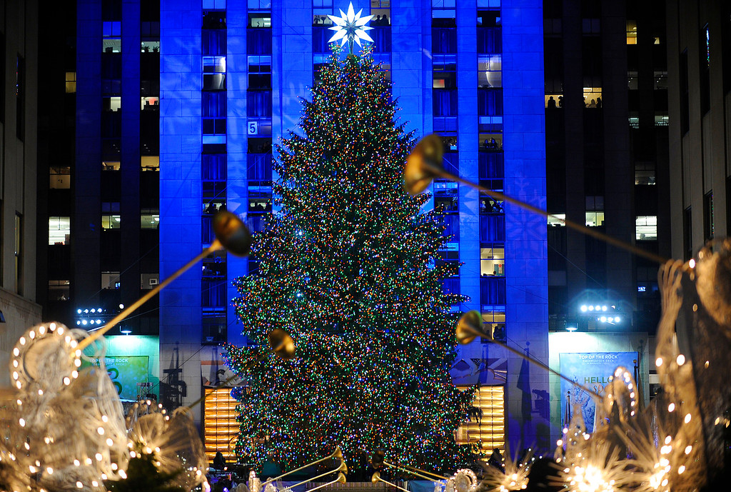 . The Rockefeller Center Christmas tree stands lit during the 77th annual lighting ceremony Wednesday, Dec. 2, 2009 in New York. (AP Photo/Stephen Chernin)