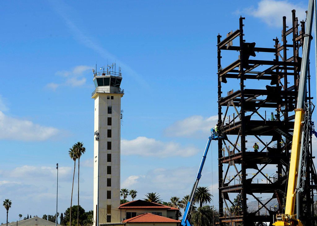. The current Control Tower/ Base Ops stands at left, as the new control tower is under construction at March Air Reserve Base in Riverside March  6, 2013.   The tower is slated to be completed by January 2015. GABRIEL LUIS ACOSTA/STAFF PHOTOGRAPHER.