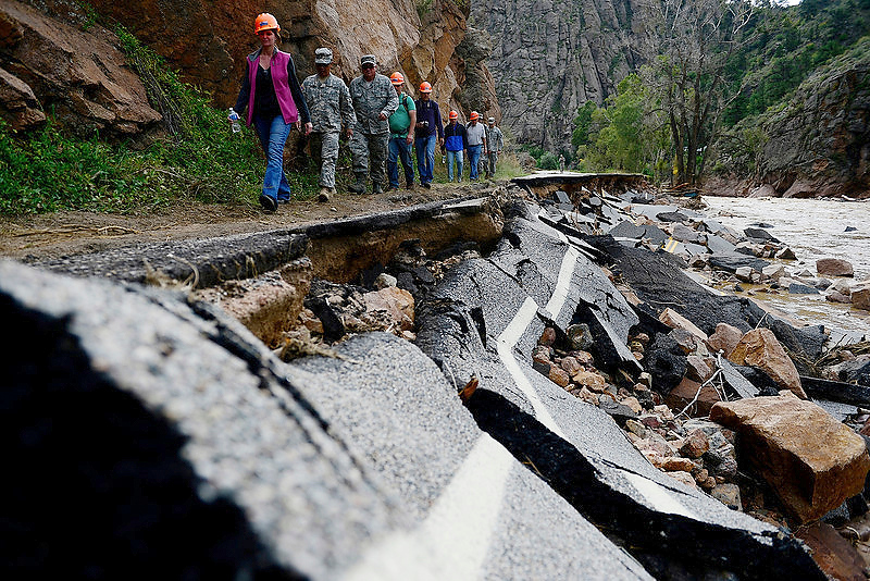 . Colorado National Guard soldiers lead a group of CDOT and state employees during a tour to look at the damage caused by recent flooding in the area on U.S. Highway 36 between Lyons and Pinewood Springs. Pavement is missing in many section of the road that connects Lyons to Estes Park. (Photo by Aaron Ontiveroz/The Denver Post)