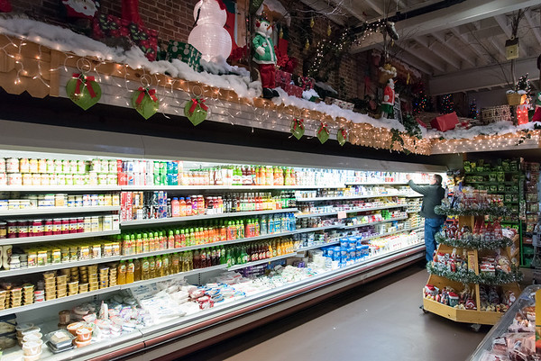 11/30/18 Wesley Bunnell   Staff Shoppers at Roly Poly Bakery in New Britain are shown standing under a section of Christmas decorations on Friday afternoon.