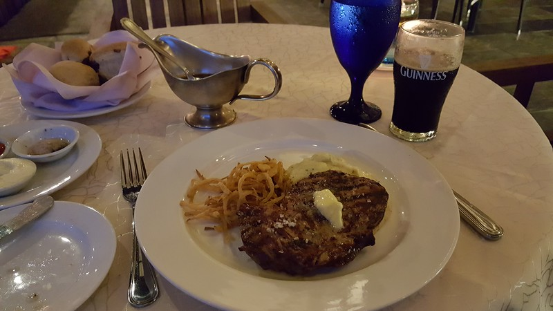 Steak, fried onions and mashed potatoes paired with a Guinness Stout.  Yum!