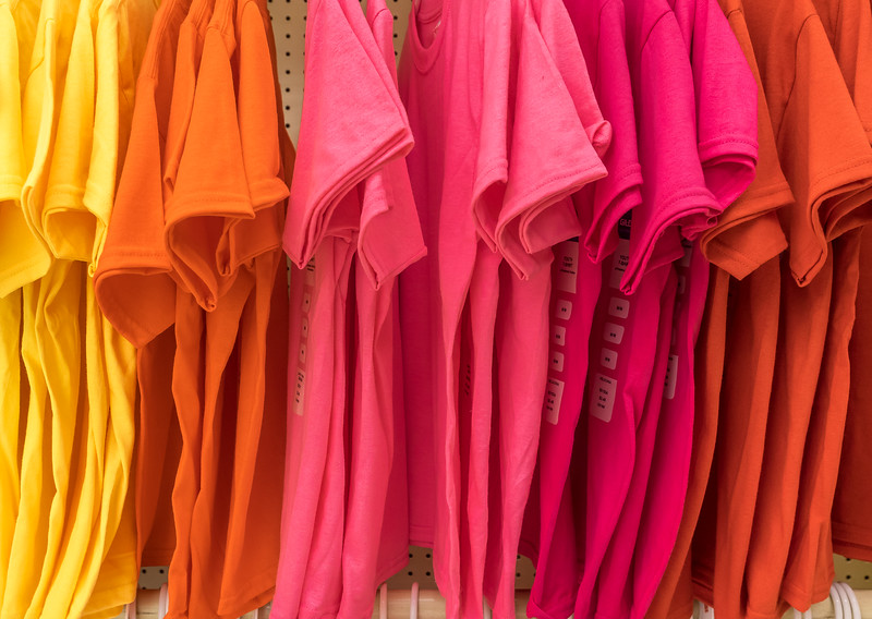 Colorful T-Shirts Hung on a Rack