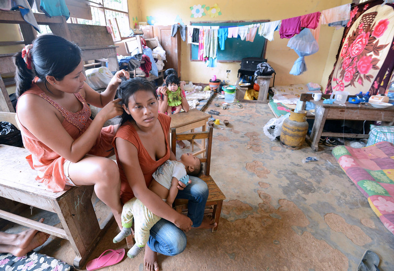 . Women and children of Puerto Yumani remain at a refuge in Rurrenabaque, Bolivia, on February 3, 2014, after their community was flooded due to the overflowing of the Beni river during heavy rains. (Aizar Raldes Nunez/AFP/Getty Images)