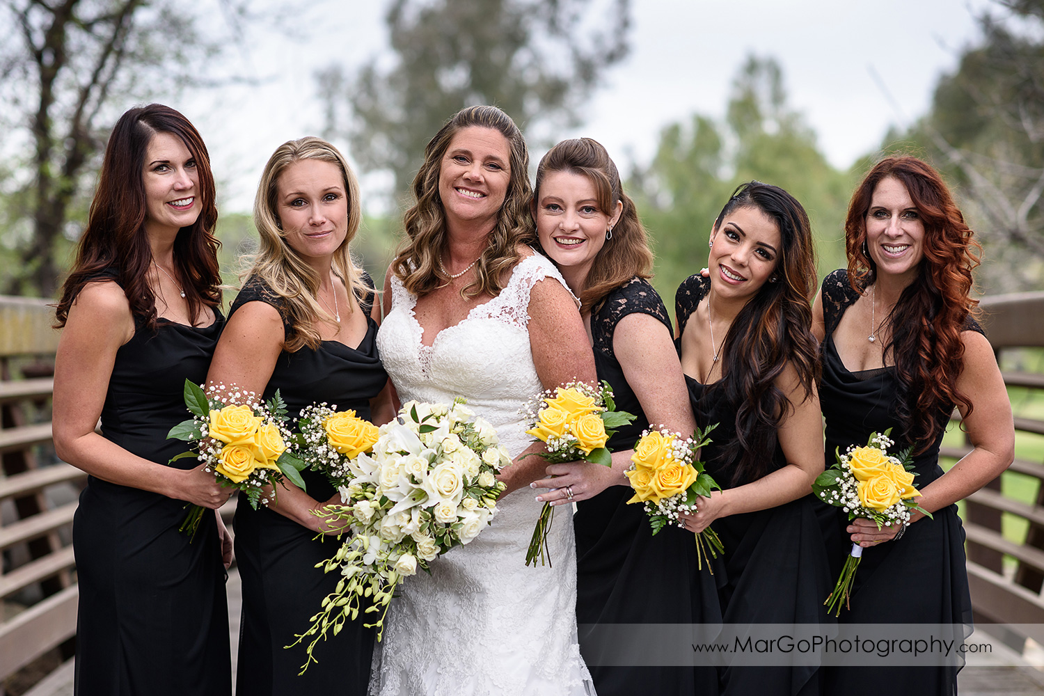 bride and bridesmaids on the bridge at Las Positas Golf Course in Livermore