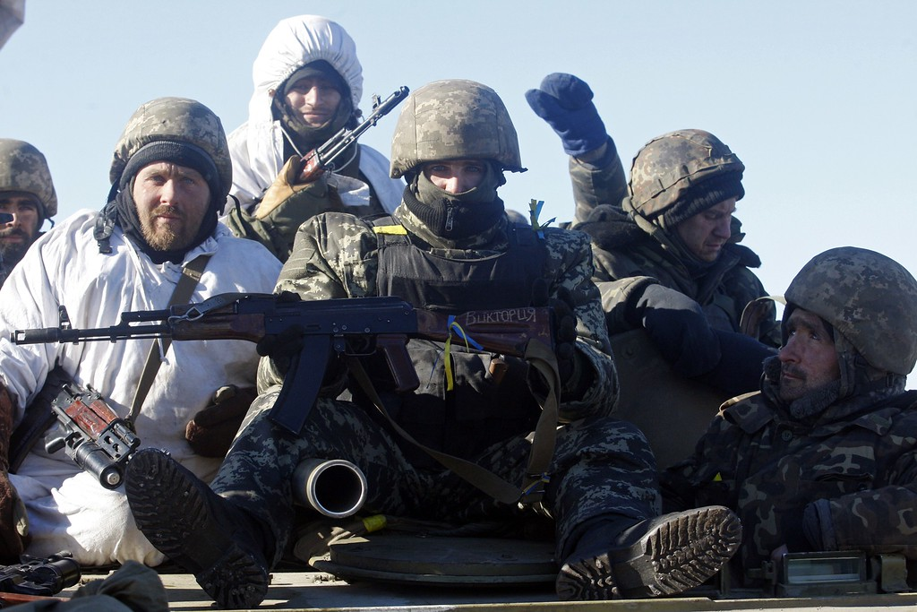 """. Ukrainian soldiers riding a tank arrive near Artemivsk after leaving the eastern Ukrainian city of Debaltseve in the Donetsk region on February 18, 2015. Ukrainian troops pulled out of the hotspot eastern town of Debaltseve after it was stormed by pro-Russian rebels in what the EU said was a \""""clear violation\"""" of an internationally-backed truce. ANATOLII STEPANOV/AFP/Getty Images"""