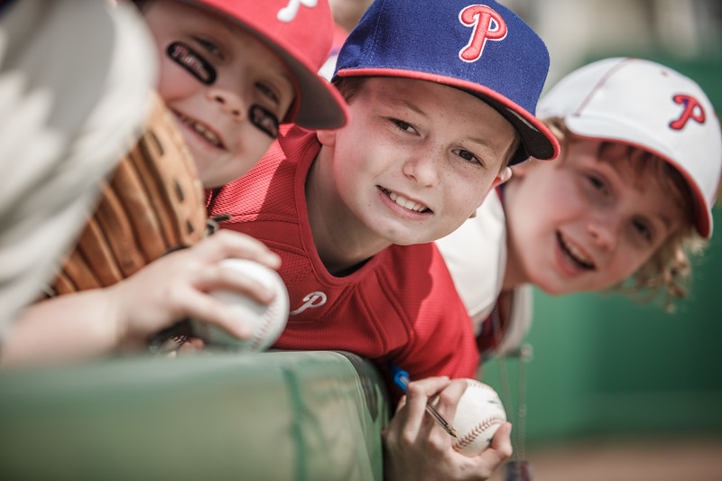 Three young boys at a baseball game.