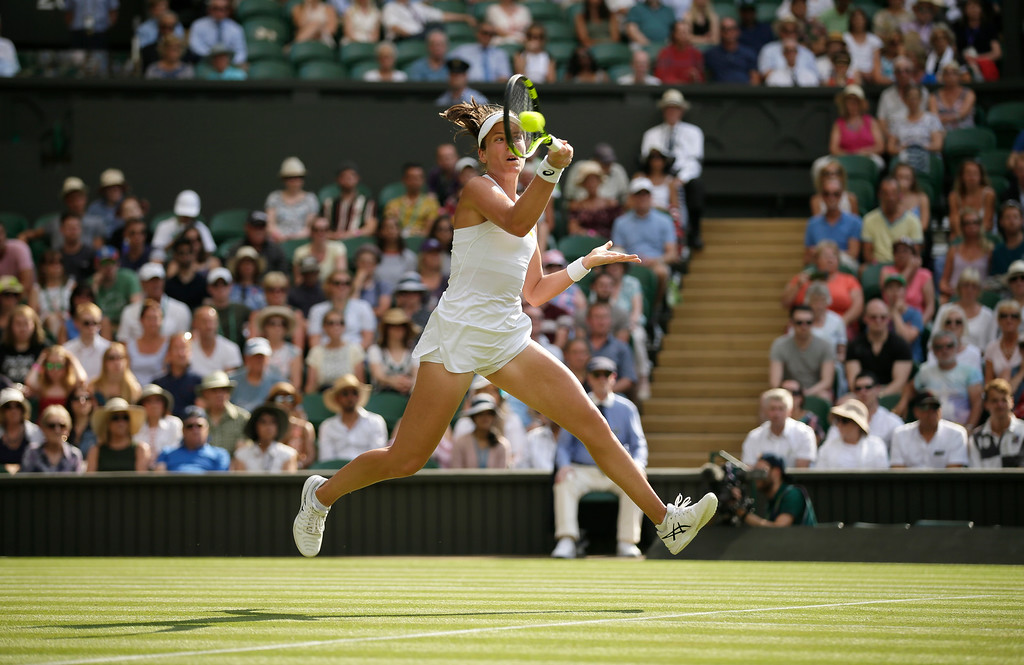 . Britain\'s Johanna Konta returns the ball to Slovakia\'s Dominika Cibulkova during their women\'s singles match, on the fourth day of the Wimbledon Tennis Championships in London, Thursday July 5, 2018. (AP Photo/Tim Ireland)