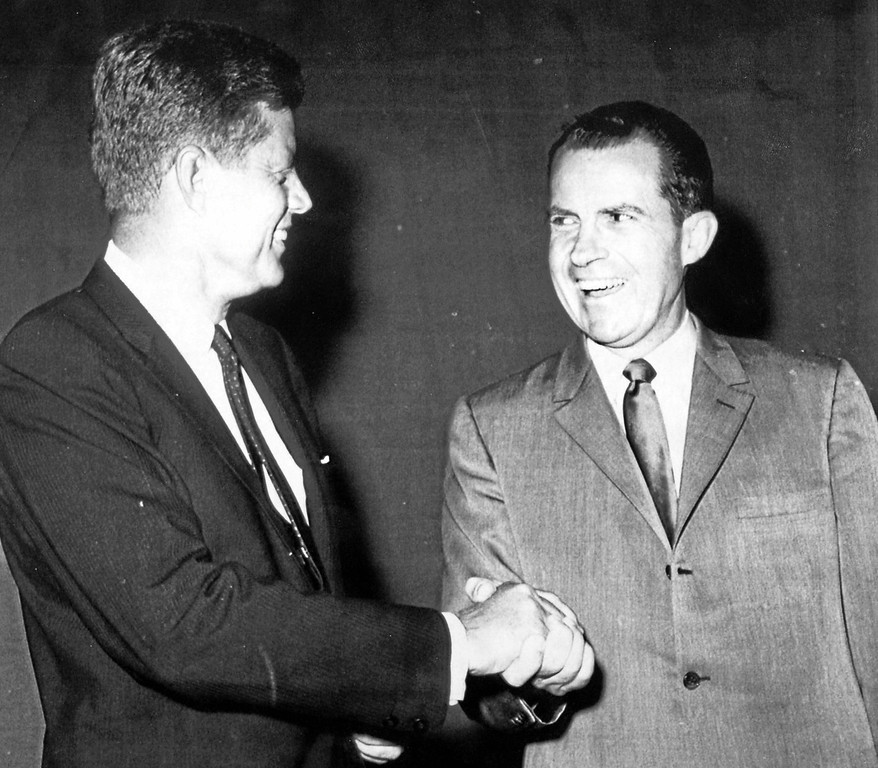 . Presidential candidates John F. Kennedy and Richard M. Nixon shake hands before their presidential debate on Sept. 26, 1960, in Chicago.