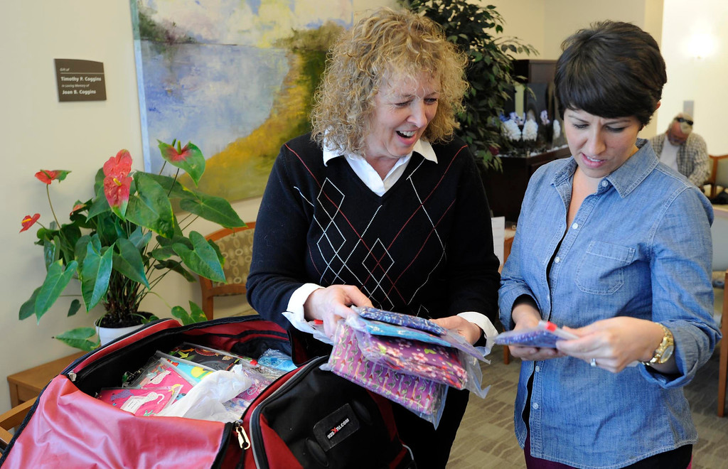 . Brenda Jones shows wraps to Liz Barnett. Jones created her own open-in-the-front wrap when she was undergoing treatment for breast cancer, crafting an option to the hospital gown, utilizing soft and colorful flannel fabrics. Fellow patients loved them and her nonprofit Hug Wraps was born. Jones visited Providence Saint Joseph Medical Center�s Roy and Patricia Disney Family Cancer Center and gave patients free wraps. Burbank, CA 2/22/2013(John McCoy/Staff Photographer)