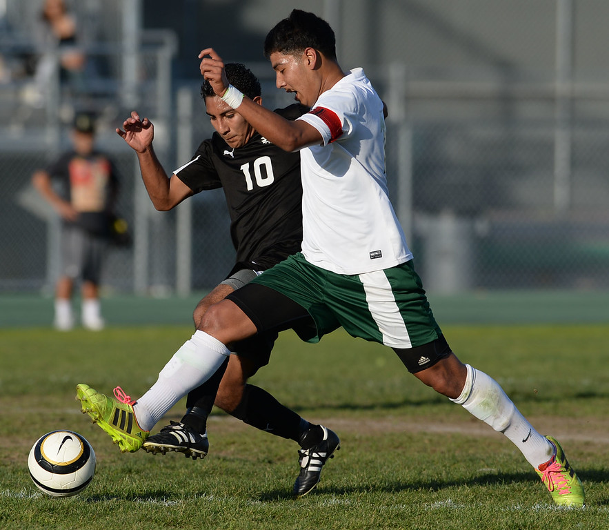 . Narbonne\'s Angel Hernandez (16) races the ball down field against  San Pedro\'s Andres Toribio (10) in a Marine League boys soccer game Wednesday, February 12, 2014, Harbor City, CA.  Narbonne won 2-0 and seals the league title. Photo by Steve McCrank/Daily Breeze