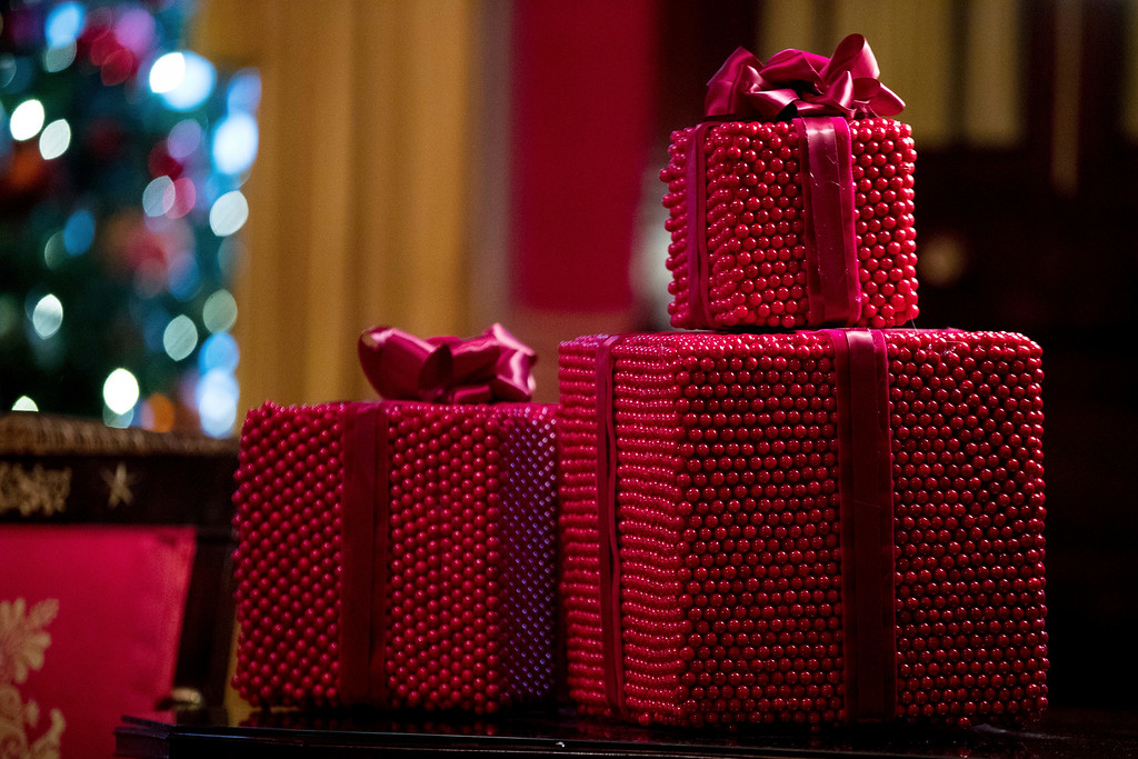 . Decorative presents are on display in the Red Room at the White House during a preview of the 2016 holiday decor, Tuesday, Nov. 29, 2016, in Washington. (AP Photo/Andrew Harnik)