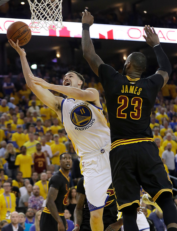 . Golden State Warriors guard Klay Thompson (11) shoots against Cleveland Cavaliers forward LeBron James (23) during the first half of Game 2 of basketball\'s NBA Finals in Oakland, Calif., Sunday, June 4, 2017. (AP Photo/Marcio Jose Sanchez)