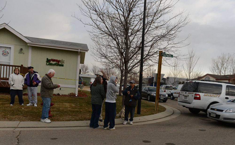 . Residents are shocked by the news, Tuesday, December 18, 2012, where four people were found dead in a home in Longmont. RJ Sangosti, The Denver Post