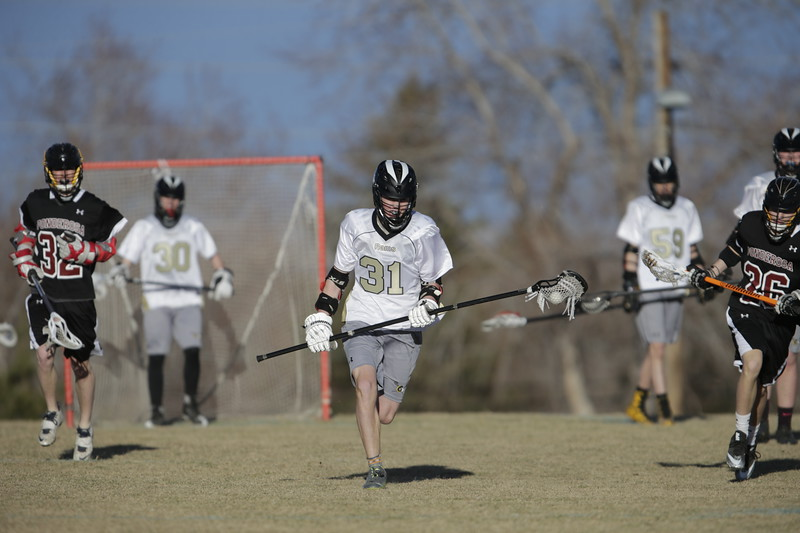 JPM0189-JPM0189-Jonathan first HS lacrosse game March 9th.jpg