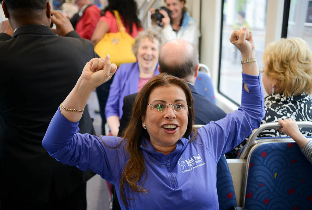 . St. Paul Schools superintendent Valeria Silva reacts after the first train leaves the Hamline station.  (Pioneer Press: Ben Garvin)