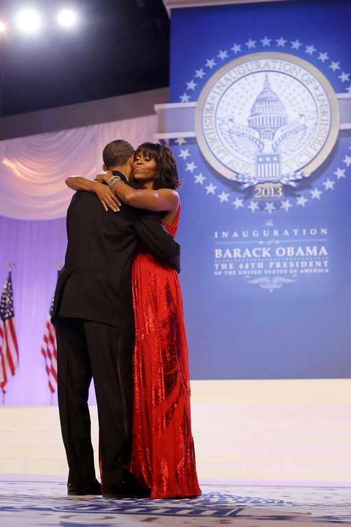 ". President Barack Obama and first lady Michelle Obama, wearing a ruby colored chiffon and velvet Jason Wu gown, dance as singer Jennifer Hudson, right, sings Al Green\'s ""Let\'s Stay Together\"" at the Inaugural Ball at the Washington Convention Center during the 57th Presidential Inauguration in Washington, Monday, Jan. 21, 2013. (AP Photo/Charles Dharapak)"