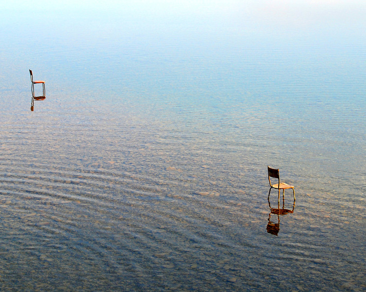 Standing on a bridge in Italy...there were just two chairs sitting in the water. I thought it was surreal.