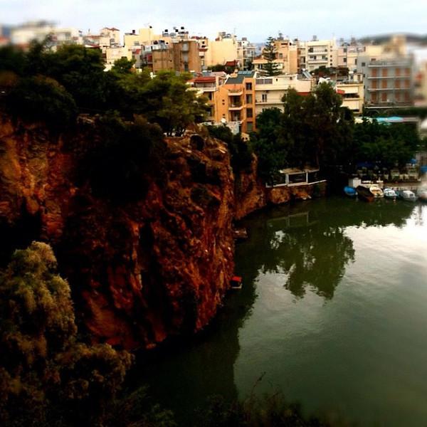 Looking down over rocks, lake & bay at Agois Nikolaos. #Crete