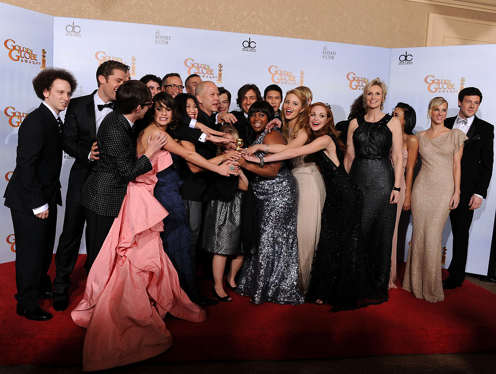 """. BEVERLY HILLS, CA - JANUARY 16: (L-R) Matthew Morrison, Kevin McHale, Lea Michele, Jenna Ushkowitz, Darren Criss, producer Ryan Murphy, Mark Salling, Chris Colfer, Lauren Potter, Amber Riley, Harry Shum Jr., Dianna Agron, Jayma Mays, Jane Lynch, Naya Rivera, Heather Morris, Cory Monteith and cast/crew of \""""Glee\"""" pose with the award for Best Television Series (Comedy or Musical) for \""""Glee\"""" in the press room at the 68th Annual Golden Globe Awards held at The Beverly Hilton hotel on January 16, 2011 in Beverly Hills, California. (Photo by Kevin Winter/Getty Images)"""