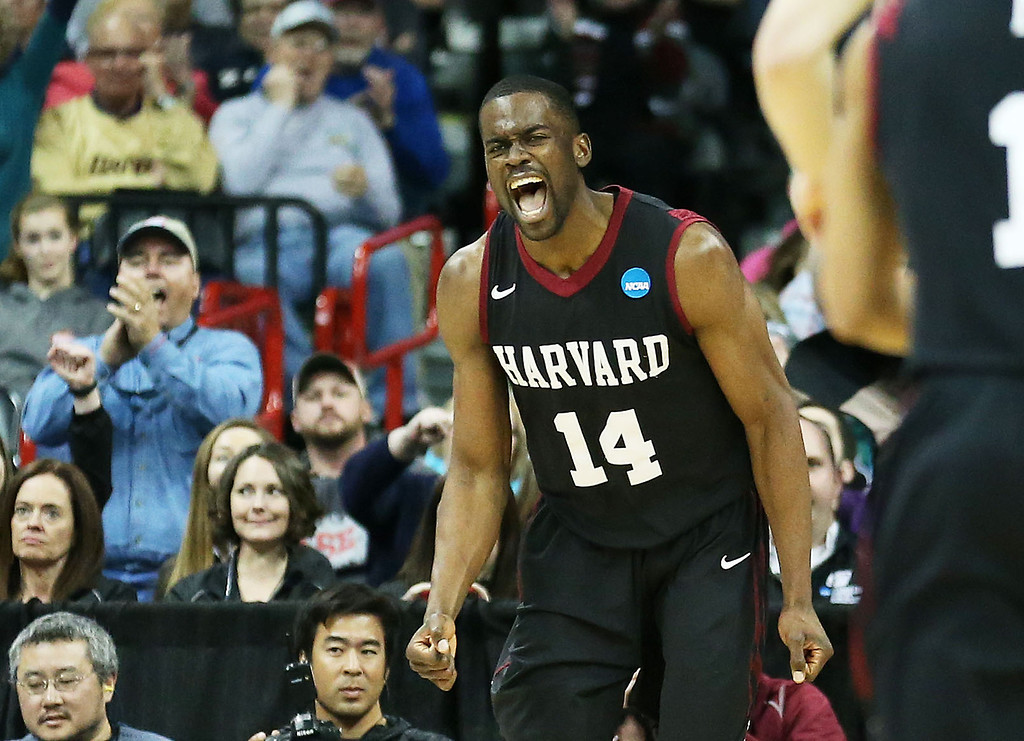 . SPOKANE, WA - MARCH 22:  Steve Moundou-Missi #14 of the Harvard Crimson celebrates in the second half against the Michigan State Spartans during the Third Round of the 2014 NCAA Basketball Tournament at Spokane Veterans Memorial Arena on March 22, 2014 in Spokane, Washington.  (Photo by Stephen Dunn/Getty Images)