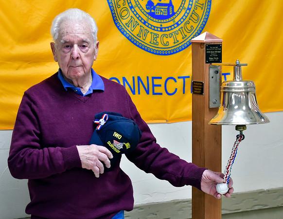 12/7/2019 Mike Orazzi | StaffrU.S. Marine Corps veteran and Iwo Jima survivor Joe Caminiti rings the U.S.S. Kidd bell at the Bristol American Legion Seicheprey Post 2 on Saturday morning for the Pearl Harbor Day ceremony.