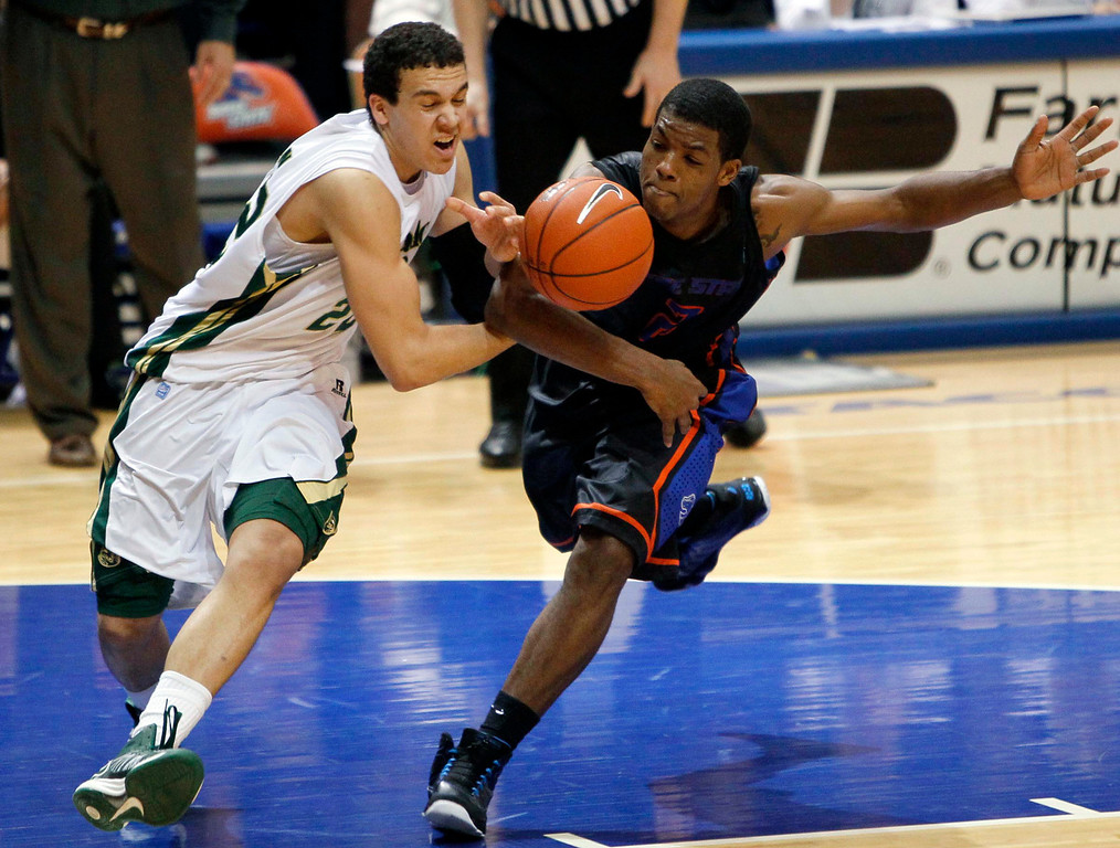 . Colorado State guard Dorian Green (22) is fouled by Boise State guard Derrick Marks (2) during an NCAA college basketball game in Boise, Idaho, Saturday, March 2, 2013.  (AP Photo/Darin Oswald)