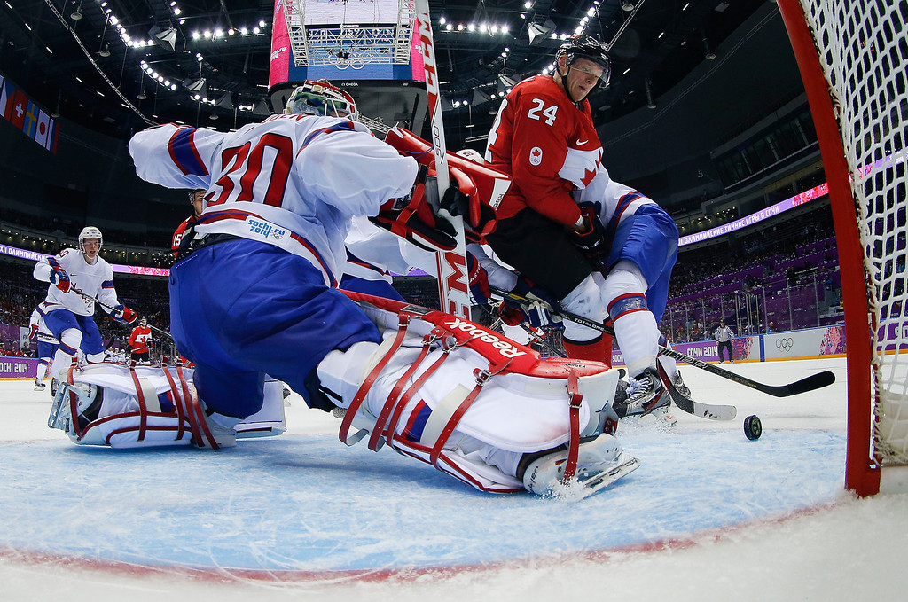 . Norway goaltender Lars Haugen stretches to block a shot by Canada forward Corey Perry in the third period of a men\'s ice hockey game against Canada at the 2014 Winter Olympics,Thursday, Feb. 13, 2014, in Sochi, Russia. (AP Photo/Julio Cortez, Pool)