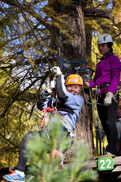 Kiersten on the zip line while Katerina look on