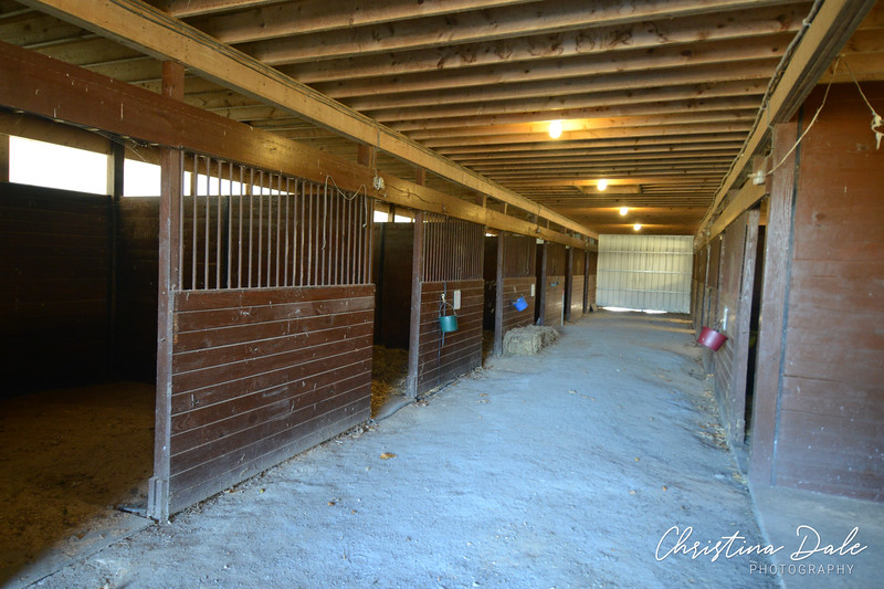 Inside 10 stall barn, blue stone floor needs grading by current owner.