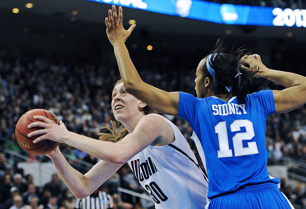 . Connecticut forward Breanna Stewart (30) drives to the basket against Kentucky forward Jelleah Sidney (12) in the first half of a women\'s NCAA regional final basketball game in Bridgeport, Conn., Monday, April 1, 2013. Stewart scored 21 in the team\'s 83-53 victory. (AP Photo/Jessica Hill)