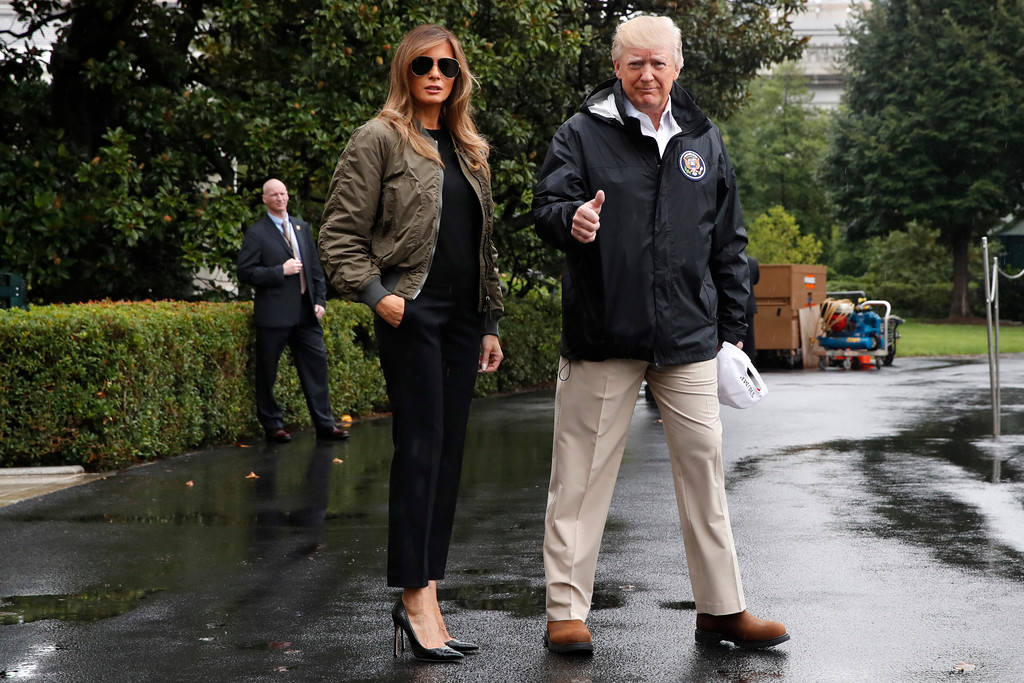 . FILE - In this Aug. 29, 2017 file photo, President Donald Trump, accompanied by first lady Melania Trump, gives a thumbs-up as they walk to Marine One on the South Lawn of the White House in Washington, for a short trip to Andrews Air Force Base, Md., then onto Texas to survey the response to Hurricane Harvey.  Slovenian-born Melania Trump has been unafraid to go against her husband�s �America First� agenda, and stay true to her roots, if there�s a message to be taken from her bold, foreign-flavored first lady wardrobe in 2017.   (AP Photo/Jacquelyn Martin)