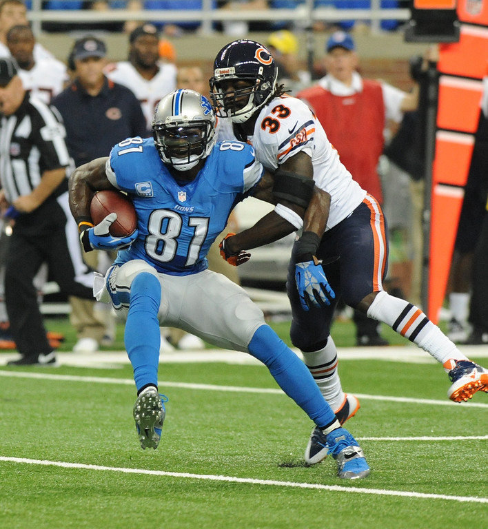 . Detroit Lions wide receiver Calvin Johnson (81) makes a reception in front of Chicago Bears cornerback Charles Tillman (33) during the first quarter of an NFL football game at Ford Field in Detroit, Sunday, Sept. 29, 2013. (AP Photo/Jose Juarez)