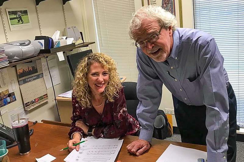 Brenda Austin (left) and David Weck (right) are hard at work at Hope Publishing.