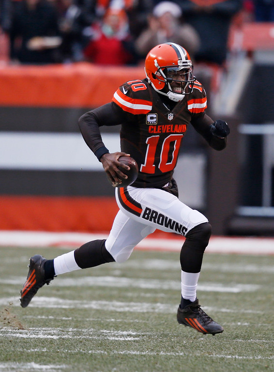 . Cleveland Browns quarterback Robert Griffin III (10) scrabbles in the first half of an NFL football game against the San Diego Chargers, Saturday, Dec. 24, 2016, in Cleveland. (AP Photo/Ron Schwane)