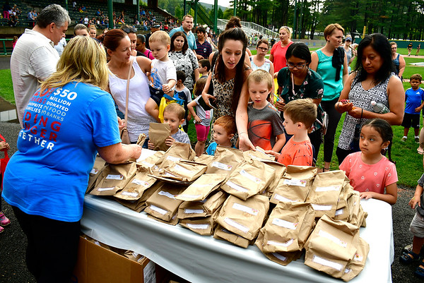 8/22/2019 Mike Orazzi | Staff Shop Rite's Mary Lou Grendziszewski passes out prizes during the second annual Mayors Back to School Pencil Hunt held at Muzzy Field in Bristol on Thursday evening.