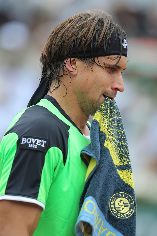 . Spain\'s David Ferrer holds his towel in his match against compatriot Rafael Nadal in the final of the French Open tennis tournament, at Roland Garros stadium in Paris, Sunday June 9, 2013. Nadal won in three sets 6-3, 6-2, 6-3. (AP Photo/Michel Euler)