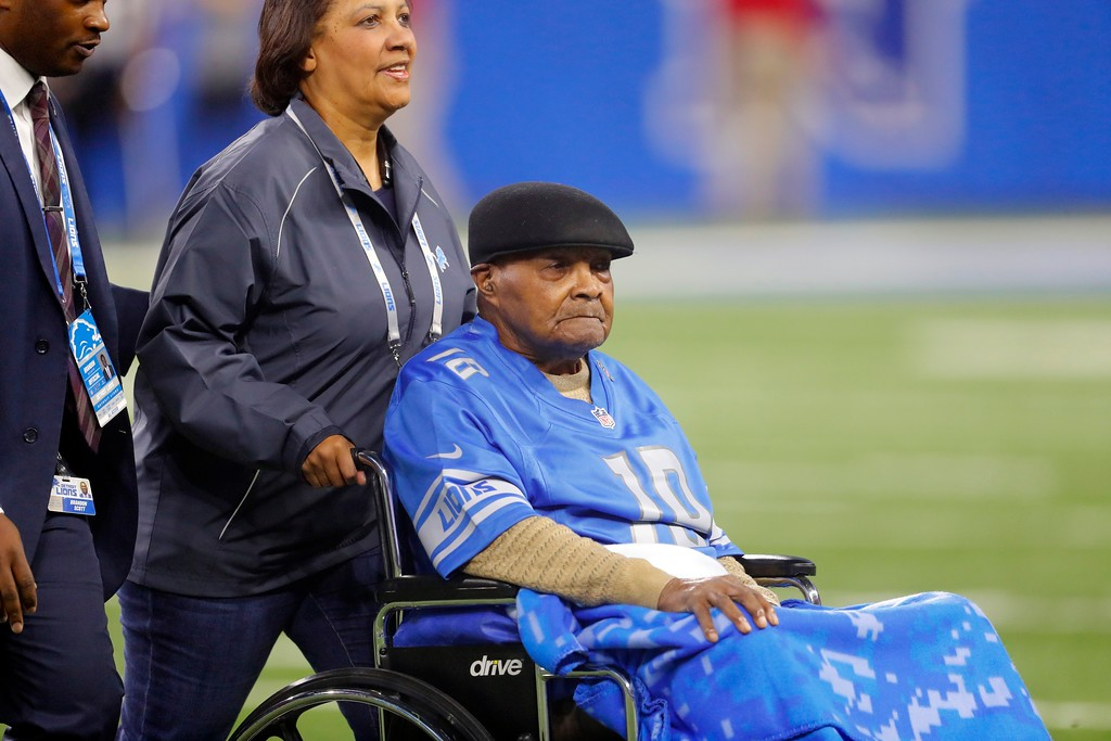 . Wally Triplett, a member of the 1949 Detroit Lions is wheeled onto the field before the first half of an NFL football game between the Detroit Lions and the Cleveland Browns, Sunday, Nov. 12, 2017, in Detroit. (AP Photo/Paul Sancya)