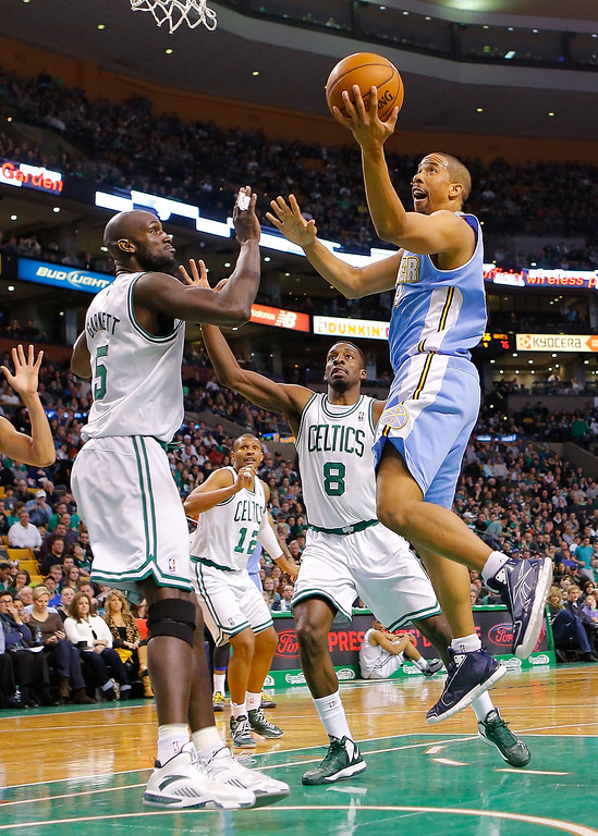 . BOSTON, MA - FEBRUARY 10: Andre Miller #24 of the Denver Nuggets drives to the basket in front of Kevin Garnett #5 of the Boston Celtics during the game on February 10, 2013 at TD Garden in Boston, Massachusetts.  (Photo by Jared Wickerham/Getty Images)
