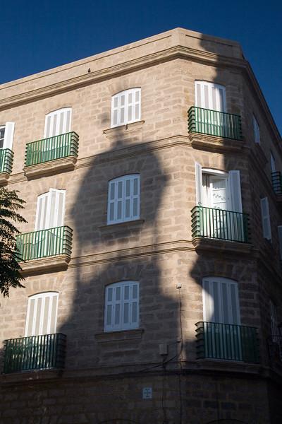 Shadows and highlights on a building of Cadiz city center, Spain